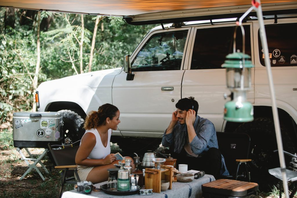 couple outside RV